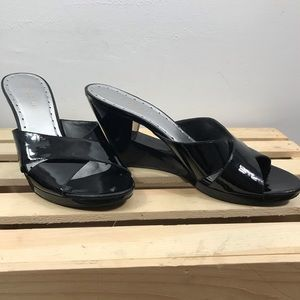BCBGirls black patent leather wedge